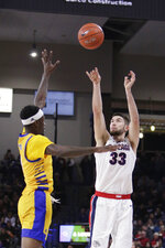 Gonzaga forward Killian Tillie, right, shoots over Cal State Bakersfield guard Taze Moore during the first half of an NCAA college basketball game in Spokane, Wash., Saturday, Nov. 23, 2019. (AP Photo/Young Kwak)