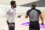 Rhode Island head coach David Cox, left, talks with an official in the first half of an NCAA college basketball game against South Florida, Saturday, Nov. 28, 2020, in Uncasville, Conn. (AP Photo/Jessica Hill)