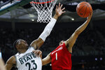 Maryland guard Anthony Cowan Jr. (1) drives on Michigan State forward Xavier Tillman (23) in the first half of an NCAA college basketball game in East Lansing, Mich., Saturday, Feb. 15, 2020. (AP Photo/Paul Sancya)