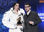 Annie Clark, also known as St. Vincent, left, and Jack Antonoff accept the award for best rock song for