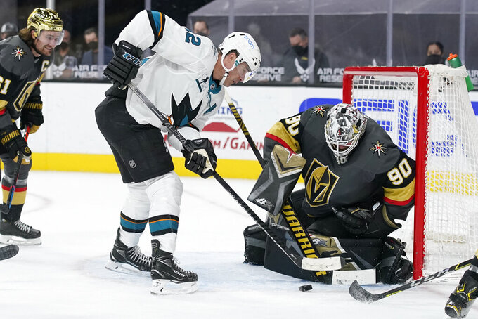 San Jose Sharks center Patrick Marleau (12) attempts a shot on Vegas Golden Knights goaltender Robin Lehner (90) during the third period of an NHL hockey game Monday, April 19, 2021, in Las Vegas. (AP Photo/John Locher)