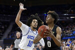 Washington forward Jaden McDaniels shoots around UCLA guard Tyger Campbell during the second half of an NCAA college basketball game in Los Angeles, Saturday, Feb. 15, 2020. (AP Photo/Chris Carlson)