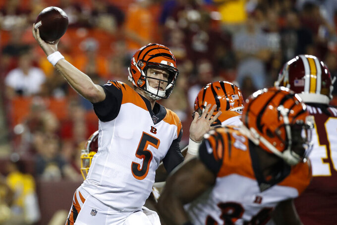 Cincinnati Bengals quarterback Ryan Finley (5) throws a pass during the first half of the team's NFL preseason football game against the Washington Redskins, Thursday, Aug. 15, 2019, in Landover, Md. (AP Photo/Alex Brandon)