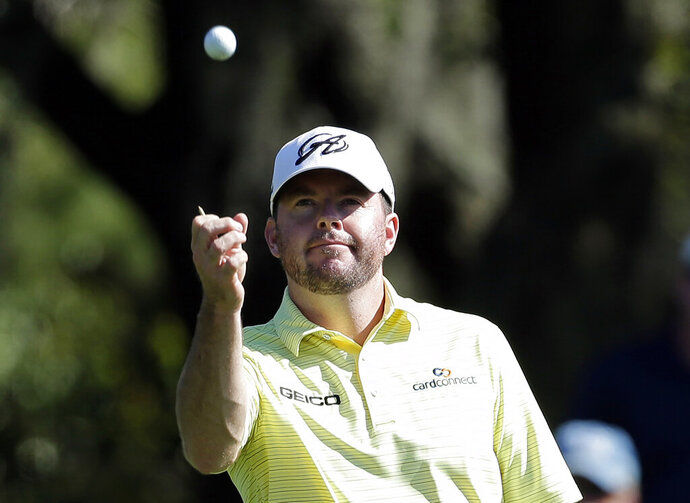 FILE - In this March 15, 2014, file photo, Robert Garrigus looks at his golf ball during the third round of the Valspar Championship golf tournament at Innisbrook in Palm Harbor, Fla. Garrigus has become the first player suspended by the PGA Tour for a drug of abuse. Garrigus says on Twitter he had a relapse and tested positive for marijuana, which is banned under the tour's anti-doping policy. He has been suspended for three months. (AP Photo/Chris O'Meara, File)
