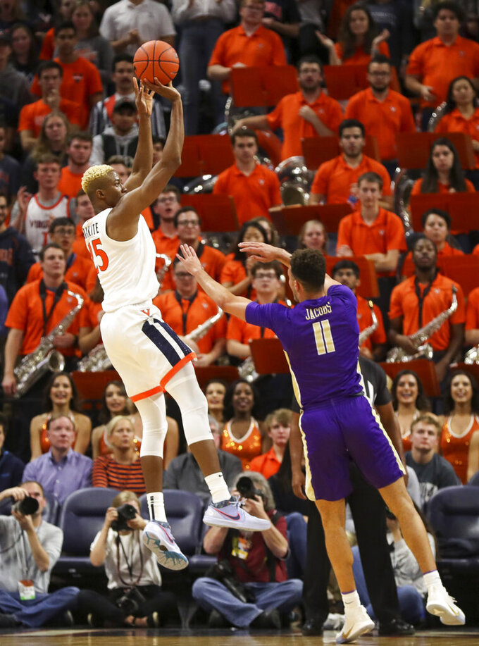 Virginia forward Mamadi Diakite (25) shoots over James Madison forward Zach Jacobs (11) during the first half of an NCAA college basketball game in Charlottesville, Va., Sunday, Nov. 10, 2019. (AP Photo/Andrew Shurtleff)