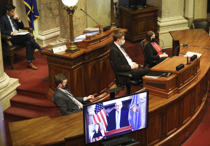Wisconsin Gov. Tony Evers delivers his State of the State Address virtually as members of the Senate watch from the Senate Chambers at the Wisconsin State Capitol in Madison, Wis., Tuesday, Jan. 12, 2021. (Amber Arnold/Wisconsin State Journal via AP)