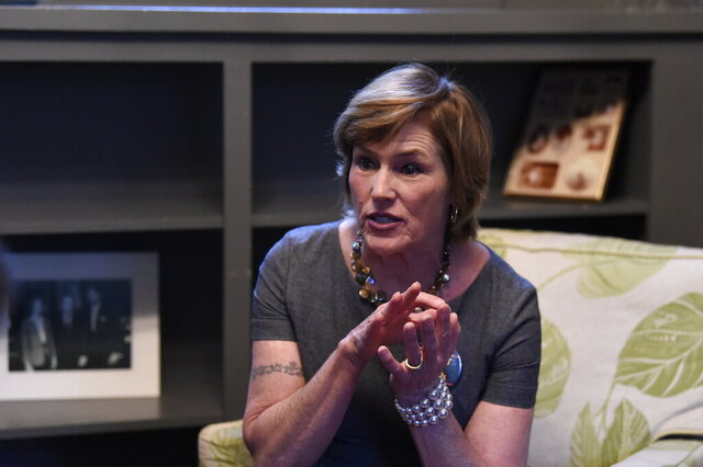 Kat Taylor, wife of Democratic presidential candidate Tom Steyer, speaks with reporters during an open house at the home she's renting in Columbia, S.C., on Sunday, Feb. 16, 2020. (AP Photo/Meg Kinnard)