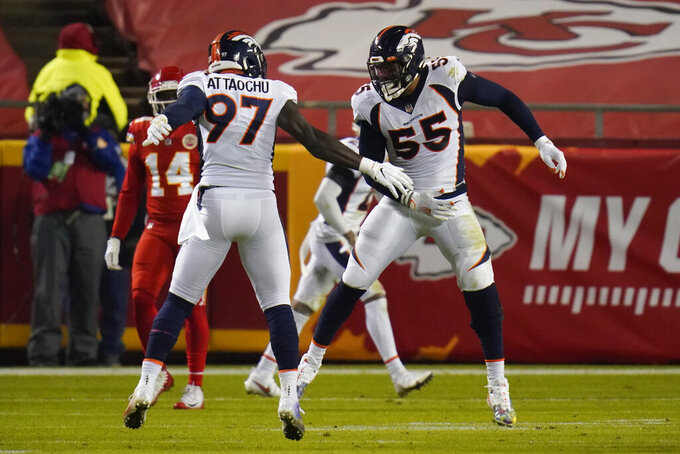 Denver Broncos outside linebacker Jeremiah Attaochu (97) celebrates with Bradley Chubb (55) after sacking Kansas City Chiefs quarterback Patrick Mahomes in the second half of an NFL football game in Kansas City, Mo., Sunday, Dec. 6, 2020. (AP Photo/Jeff Roberson)