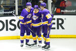 Los Angeles Kings center Trevor Moore (12) celebrates with right wing Adrian Kempe (9) and center Gabriel Vilardi (13) after Moore scored a goal during the second period of an NHL hockey game against the Vegas Golden Knights Wednesday, April 14, 2021, in Los Angeles. (AP Photo/Ashley Landis)