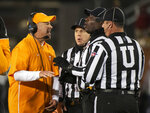 Tennessee head coach Jeremy Pruitt argues a call with the referees during the third quarter of an NCAA college football game against Missouri, Saturday, Nov. 23, 2019, in Columbia, Mo. Tennessee won the game 24-20. (AP Photo/L.G. Patterson)