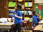 Students say the Pledge of Allegiance on their first day back to class at Roswell B. Mason Elementary School on the South Side after a Chicago Teachers Union strike closed schools for 11 days, Friday morning, Nov. 1, 2019. (Ashlee Rezin Garcia/Chicago Sun-Times via AP)