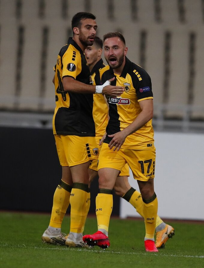 AEK's Muamer Tankovic, right, celebrates his side's first goal during the Europa League group G soccer match between AEK Athens and Leicester at the Olympic stadium in Athens, Thursday, Oct. 29, 2020. (AP Photo/Thanassis Stavrakis)