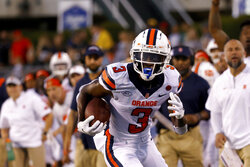 Syracuse wide receiver Taj Harris (3) runs with the ball during an NCAA football game against Ohio in Athens, Ohio, Saturday, Sept. 4, 2021. Syracuse wide receiver Taj Harris is taking his talents elsewhere. Orange coach Dino Babers confirmed Monday, Oct. 4, 2021, that the junior has decided to enter the transfer portal. (AP Photo/Kirk Irwin)