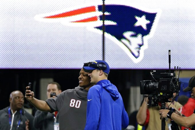 New England Patriots' Stephen Anderson, left, and Los Angeles Rams' Jared Goff pose for a picture before the NFL Super Bowl 53 football game Sunday, Feb. 3, 2019, in Atlanta. (AP Photo/David J. Phillip)