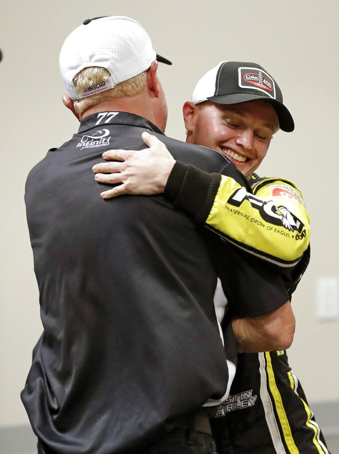 Justin Haley, right, gets a hug from one of his crew members after winning a NASCAR Cup Series auto race at Daytona International Speedway, Sunday, July 7, 2019, in Daytona Beach, Fla. (AP Photo/John Raoux)