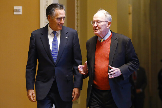 Sen. Mitt Romney, R-Utah, left, and Sen.m Lamar Alexander, R-Tenn., return to the Senate chamber after a meeting in the Majority Leaders office during a break in the impeachment trial of President Donald Trump at the U.S. Capitol Friday Jan 31, 2020, in Washington. (AP Photo/Steve Helber)