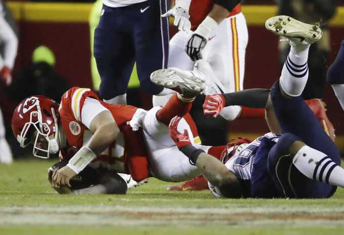 Kansas City Chiefs quarterback Patrick Mahomes (15) is sacked by New England Patriots defensive end Trey Flowers (98) during the first half of the AFC Championship NFL football game, Sunday, Jan. 20, 2019, in Kansas City, Mo. (AP Photo/Elise Amendola)