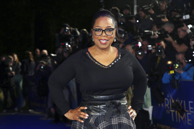 FILE - In this March 13, 2018, file photo, actress Oprah Winfrey poses for photographers upon arrival at the premiere of the film
