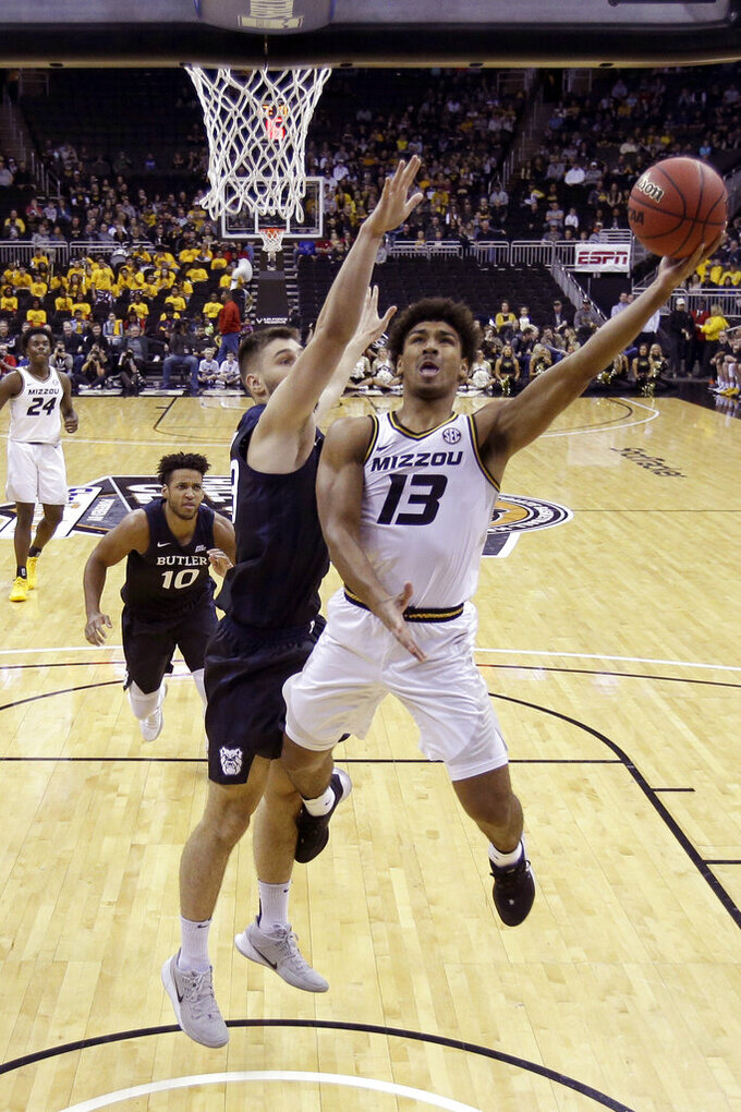 Missouri guard Mark Smith (13) shoots during the first half of an NCAA college basketball game against Butler, Monday, Nov. 25, 2019, in Kansas City, Mo. (AP Photo/Charlie Riedel)