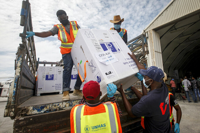 FILE - In this March 15, 2021, file photo, boxes of AstraZeneca COVID-19 vaccine manufactured by the Serum Institute of India and provided through the COVAX global initiative arrive at the airport in Mogadishu, Somalia. COVAX is providing vaccines to poorer countries lacking the clout to negotiate for them on their own, but it has only cleared 2 million doses in the past two weeks because nearly all deliveries through the program are blocked until as late as June. On March 25, COVAX announced a major setback in its vaccine rollout because a surge in infections in India had caused the Serum Institute of India to cater to domestic demand, resulting in a delay in global shipments of up to 90 million doses. (AP Photo/Farah Abdi Warsameh, File)