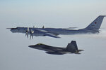 FILE - In this Monday, March 9, 2020 file photo released by the North American Aerospace Defense Command (NORAD), a Russian Tu-142 maritime reconnaissance aircraft, top right, is intercepted near the Alaska coastline. Two Russian aircraft that came within 50 miles (80 kilometers) of Unimak Island along Alaska's Aleutian chain were intercepted late Wednesday, June 24, 2020, military officials said Thursday. The incident marked the fifth time this month that such an intercept has taken place, Gen. Terrence J. O'Shaughnessy, commander of the North American Aerospace Defense Command, said in a release. (North American Aerospace Defense Command via AP,File)