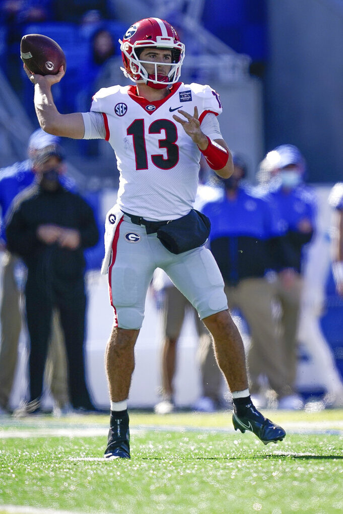 Georgia quarterback Stetson Bennett (13) passes the ball during the second half of an NCAA college football game against Kentucky, Saturday, Oct. 31, 2020, in Lexington, Ky. (AP Photo/Bryan Woolston)