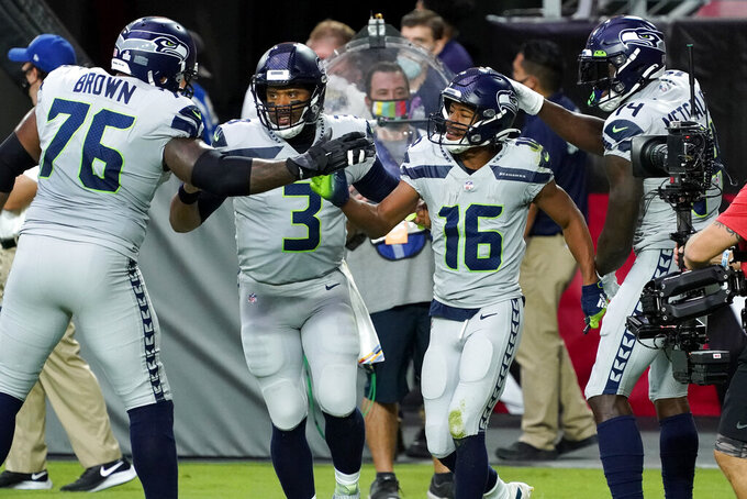 Seattle Seahawks wide receiver Tyler Lockett (16) celebrates his touchdown with quarterback Russell Wilson (3), offensive tackle Duane Brown (76) and offensive tackle Cedric Ogbuehi (74) during the first half of an NFL football game against the Arizona Cardinals, Sunday, Oct. 25, 2020, in Glendale, Ariz. (AP Photo/Rick Scuteri)