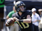 Wake Forest's Sam Hartman (10) looks to pass against Notre Dame in the first half of an NCAA college football game in Winston-Salem, N.C., Saturday, Sept. 22, 2018. (AP Photo/Chuck Burton)