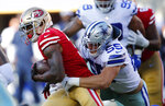 San Francisco 49ers running back Raheem Mostert, left, tries to get away from Dallas Cowboys linebacker Leighton Vander Esch (55) during the first half of an NFL preseason football game in Santa Clara, Calif., Saturday, Aug. 10, 2019. (AP Photo/John Hefti)