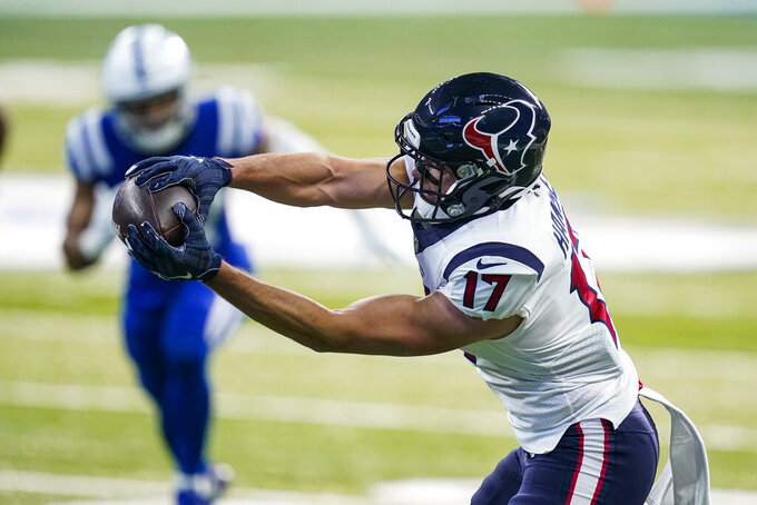 Houston Texans wide receiver Timothy Hansen makes a catch for a touchdown against the Indianapolis Colts in the first half of an NFL football game in Indianapolis, Sunday, Dec. 20, 2020. (AP Photo/Darron Cummings)