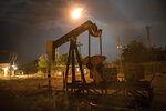 A non-operational oil pump, owned by state-owned oil company PDVSA, stands still in Cabimas, Venezuela, May 16, 2019. Venezuela's oil boom through the 1990s has since turned to bust, as its production has crashed to one-fifth of its all-time high two decades ago. (AP Photo/Rodrigo Abd)