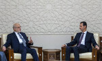 In this photo released by the Syrian official news agency SANA, shows Syrian President Bashar Assad, right, meeting with Iraqi Foreign Minister Ibrahim al-Jaafari,  in Damascus, Syria, Monday, Oct. 15, 2018. Al-Jaafari said Syria should not be isolated from its Arab neighbors, and lauded Damascus for staying
