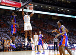 Tennessee guard Admiral Schofield (5) dunks the ball in front of Florida center Kevarrius Hayes (13) during the second half of an NCAA college basketball game Saturday, Feb. 9, 2019, in Knoxville, Tenn. Tennessee won 73-61. (AP photo/Wade Payne)