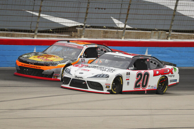Noah Gregson (9) and Harrison Burton (20) battle for position as they come out of turn four down the front stretch during a NASCAR Xfinity Series auto race at Texas Motor Speedway in Fort Worth, Texas, Saturday, Oct. 24, 2020. (AP Photo/Richard W. Rodriguez)