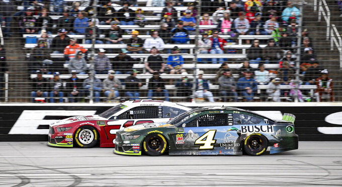 Ryan Blaney (12) and Kevin Harvick (4) battle for position during a NASCAR Cup Series auto race at Texas Motor Speedway, Sunday, Nov. 3, 2019, in Fort Worth, Texas. (AP Photo/Larry Papke)
