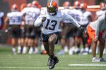 """FILE - Cleveland Browns wide receiver Odell Beckham Jr. (13) runs a route during NFL football practice in Berea, Ohio, in this Wednesday, July 28, 2021, file photo. Beckham Jr.'s comeback is in its final days, but the Browns star wide receiver didn't commit to playing Sunday against the Chicago Bears. """"We'll see,"""" Beckham said, shrugging his shoulders when pressed about his status for Cleveland's third game. (AP Photo/David Dermer, File)"""