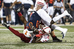 Nebraska's Dedrick Mills (26) is brought down by Illinois' Jartavius Martin (21) in the first half of an NCAA college football game, Saturday, Sept. 21, 2019, in Champaign, Ill. (AP Photo/Holly Hart)