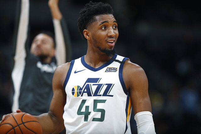 FILE - In this Jan. 30, 2020, file photo, Utah Jazz guard Donovan Mitchell looks to the bench for direction in the second half of an NBA basketball game against the Denver Nuggets in Denver. (AP Photo/David Zalubowski, File)