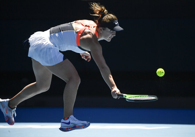 Ukraine's Elina Svitolina hits a backhand return to United States' Jessica Pegula during their fourth round match at the Australian Open tennis championship in Melbourne, Australia, Monday, Feb. 15, 2021.(AP Photo/Andy Brownbill)