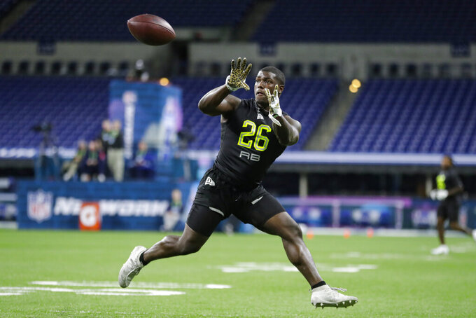 Arizona running back J J Taylor runs a drill at the NFL football scouting combine in Indianapolis, Friday, Feb. 28, 2020. (AP Photo/Michael Conroy)