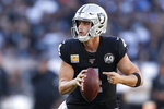 Oakland Raiders quarterback Derek Carr scrambles against the Detroit Lions during the second half of an NFL football game in Oakland, Calif., Sunday, Nov. 3, 2019. (AP Photo/D. Ross Cameron)
