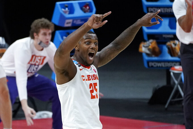 Clemson forward Aamir Simms (25) reacts to a basket against Rutgers during the first half of a men's college basketball game in the first round of the NCAA tournament at Bankers Life Fieldhouse in Indianapolis, Friday, March 19, 2021. (AP Photo/Paul Sancya)