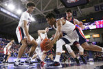 Gonzaga guard Admon Gilder, front right, dribbles in next to forward Anton Watson, left, and past Detroit Mercy forward Willy Isiani during the second half of an NCAA college basketball game in Spokane, Wash., Monday, Dec. 30, 2019. (AP Photo/Young Kwak)