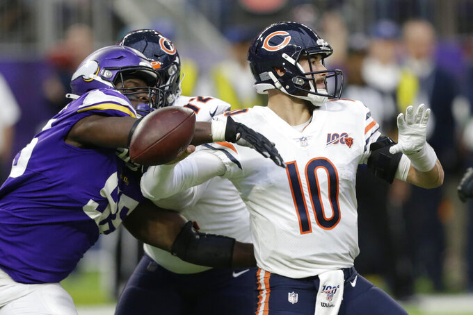 Chicago Bears quarterback Mitchell Trubisky (10) fumbles as he is hit by Minnesota Vikings defensive end Ifeadi Odenigbo, left, during the second half of an NFL football game, Sunday, Dec. 29, 2019, in Minneapolis. Odenigbo recovered the fumble. (AP Photo/Andy Clayton-King)