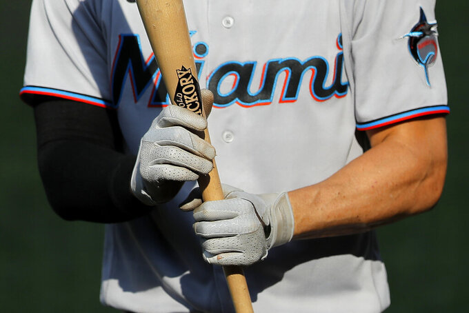 Miami Marlins' Matt Joyce holds a bat while standing at the on deck circle during the second inning in game one of a baseball double-header against the Baltimore Orioles, Wednesday, Aug. 5, 2020, in Baltimore. (AP Photo/Julio Cortez)