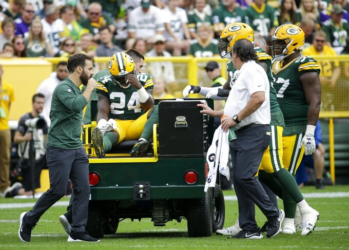 Green Bay Packers' Raven Greene is taken off the field on a cart during the second half of an NFL football game against the Minnesota Vikings Sunday, Sept. 15, 2019, in Green Bay, Wis. (AP Photo/Mike Roemer)