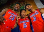 FILE - In this Tuesday, Sept. 25, 2018, file photo, Florida seniors Kevarrius Hayes (13), KeVaughn Allen (5) and Jalen Hudson (3) pose for a photo during the school's NCAA college basketball media day, in Gainesville, Fla. Next up for Florida's seniors: getting the Gators back to the NCAA Tournament for the third consecutive year. (Brad McClenny/The Gainesville Sun via AP, File)