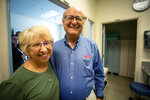 Nancy Writebol and her husband David visit the Emory University Hospital on Friday, Aug. 2, 2019, in Atlanta. Writebol and Dr. Kent Brantly contracted the deadly Ebola virus five years ago while working in Africa. They reunited Friday in Atlanta with the medical team that treated them. (AP Photo/ Ron Harris)