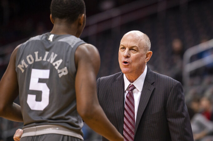 Mississippi State head coach Ben Howland talks to guard Iverson Molinar (5) during the first half of the Never Forget Tribute Classic NCAA college basketball game against Kansas Sate, Saturday, Dec. 14, 2019, in Newark, N.J. (AP Photo/Corey Sipkin)