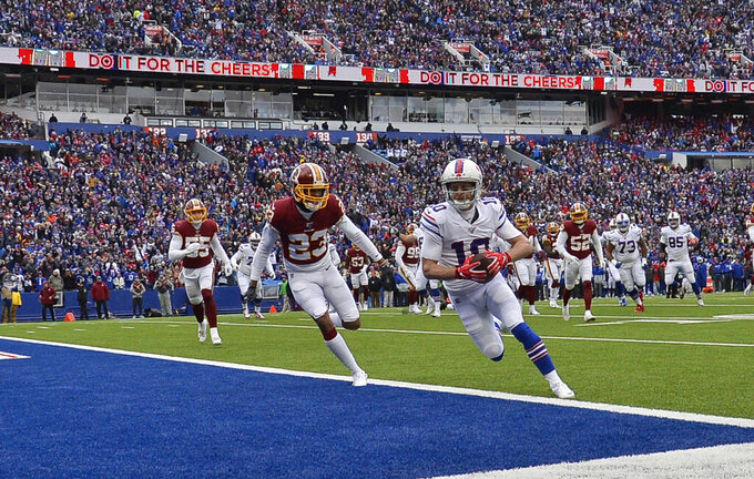 Buffalo Bills wide receiver Cole Beasley (10) scores a 6-yard touchdown against Washington Redskins cornerback Quinton Dunbar (23) during the first half of an NFL football game, Sunday, Nov. 3, 2019, in Orchard Park, N.Y. (AP Photo/Adrian Kraus)